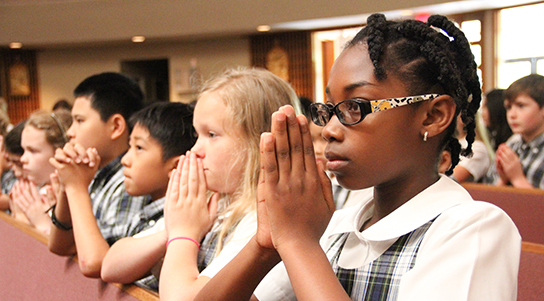 Students attend Mass at St. Elizabeth Ann Seton Catholic School, a classical curriculum school in Houston, TX